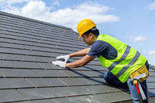 Roofing contractor with roof shingles