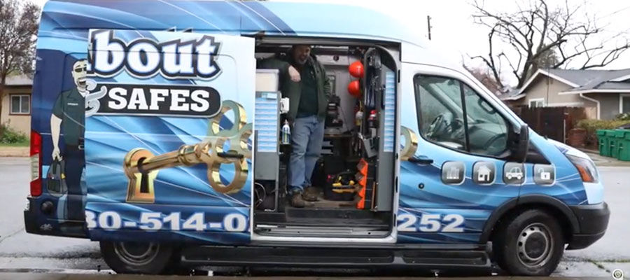 Mobile locksmith inside his Ford van