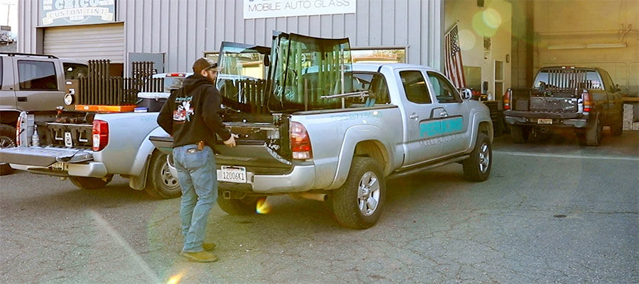 Auto glass repair technician with work truck