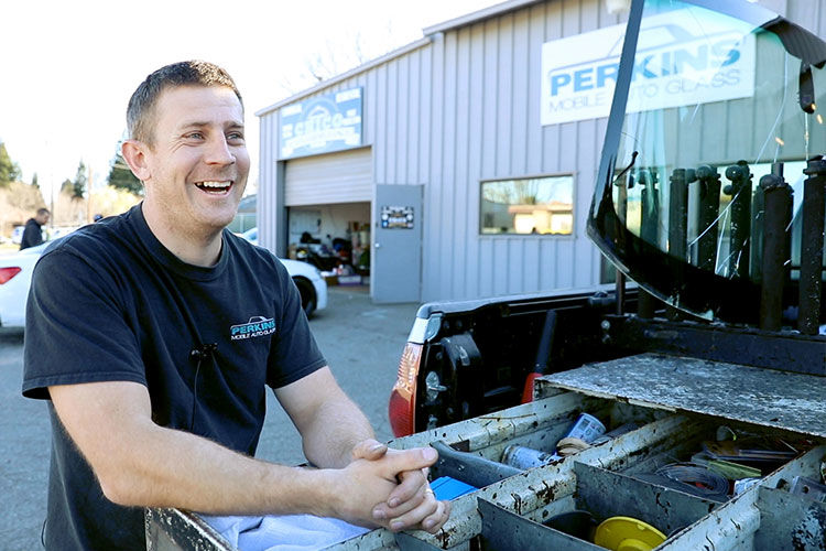 Technician with Mobile Auto Glass Repair Vehicle
