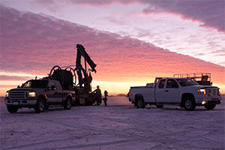 Well drilling truck at sunrise