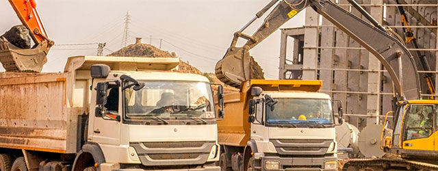 Work trucks at a construction site