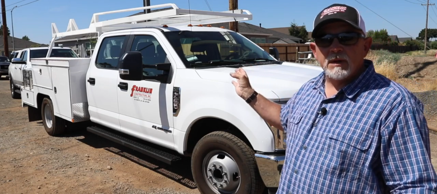 General Contractor Pointing to Work Truck with Service Utility Body