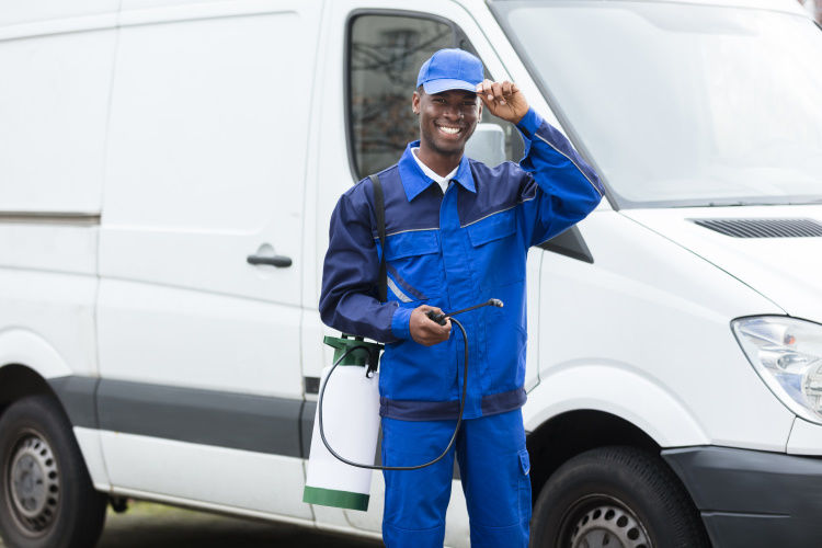 Pest Control Technician with a Work Van