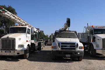 Three well drilling trucks